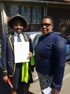 Isheanesu Mahachi and Mrs Mukogo at Arrupe college Harare isheanesu came 1st in an essay writing  competition
